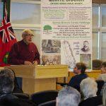 John Carew introduces presenter, Bob Dawes