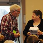 Terry Buttler, Past Chair, awards a Kobo reader as prize in draw