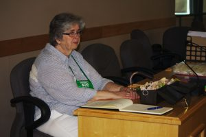 Lynn H. at the registration desk